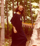 Claude Vorilhon Rael in black djellaba at seminar in 1982